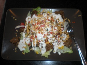 This taco salad is indulgent and easy to make and won't break the bank. So yummy! www.busybudgeter.com