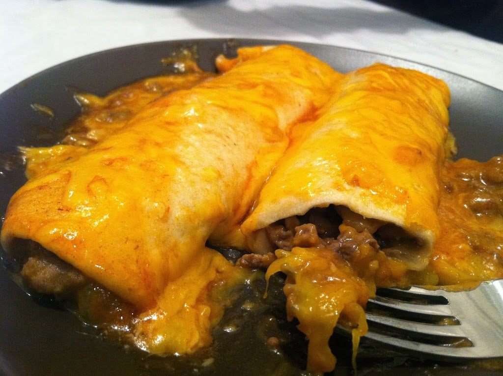 easy beefy enchiladas that are tasty and easy to make! Such a family pleaser! www.busybudgeter.com