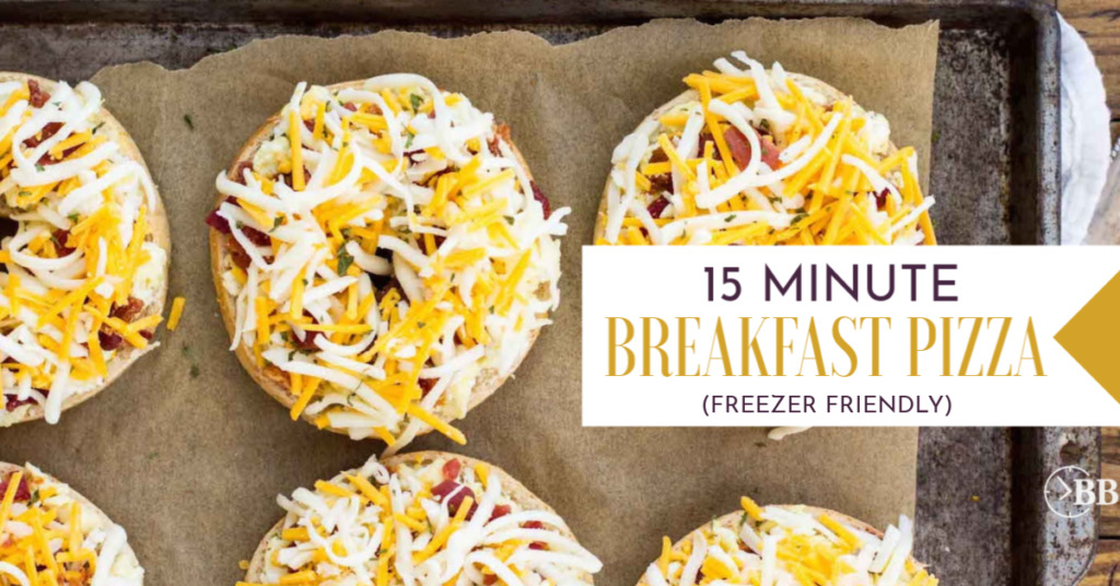 15 Minute Breakfast Pizza Bagels - Pizza bagels covered in eggs, bacon or sausage and then cheese.
