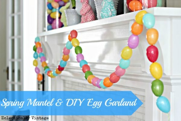 DIY Easter Crafts - this colorful egg garland adds a bit of Spring flare to any home. Hang around a doorframe, fireplace, or around windows and watch the colors POP! It's so pretty, so easy to make, and SO affordable!