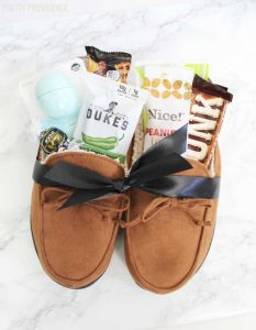 On the list of best gifts for father's day? This cute slippers gift pack! Stuff some comfy slippers with some of dad's favorite things.