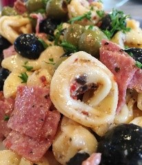 Need some easy salad recipes that don't always involve greens? Well, you'll LOVE this easy pasta salad. It's the perfect cold salad for a summer party. Whip it up and watch it disappear when you serve it!