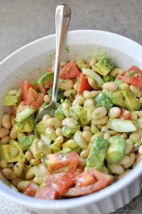 Easy salad recipes don't always have to be boring greens and tasteless dressing. This white bean salad with avocado is so far from boring! It's quick to pull together and you won't find an easier recipe for a potluck or backyard party.