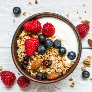 Yogurt with blueberries, granola, raspberries and dried cranberries as one of the easy dinners in the easiest Aldi meal plan, which delivers 14 dinners to your front door for under $150.