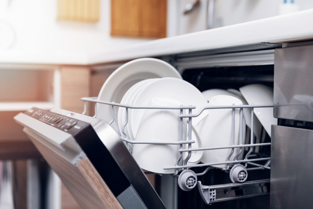open dishwasher top rack with clean dishes.