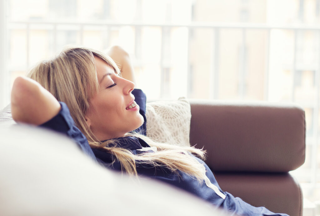 Woman relaxing on the couch.
