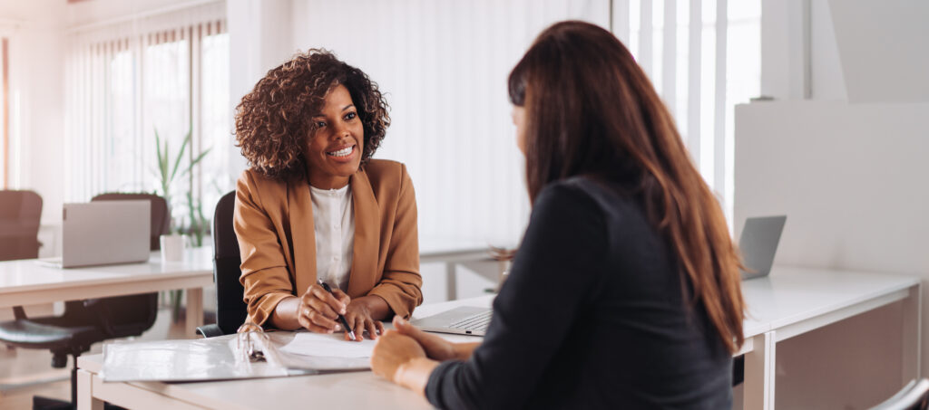 Female financial consultant manager talking with a client at the bank