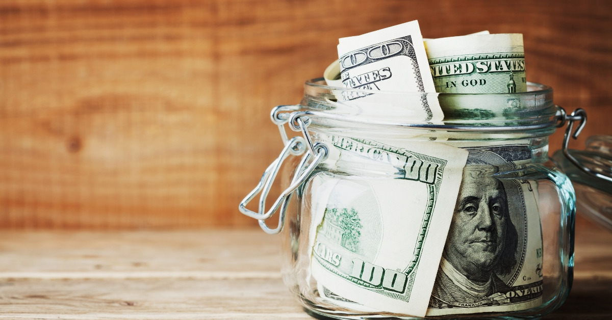 Money jar with us cash